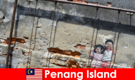 Συναρπαστική και ποικίλη τέχνη του δρόμου στο νησί Penang εκπλήσσει τους ξένους